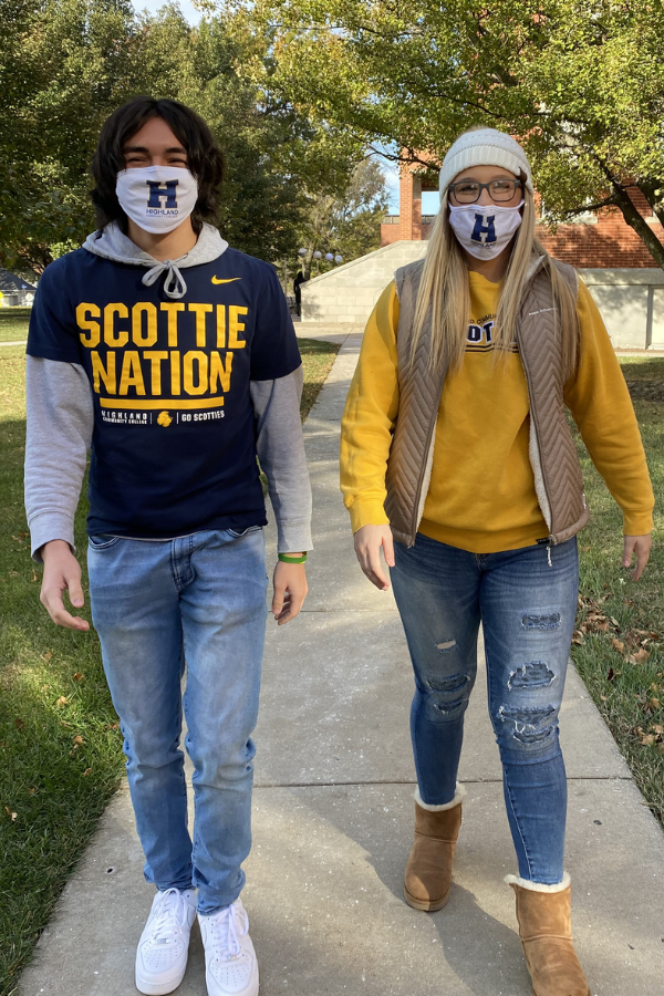 Two students walking with masks